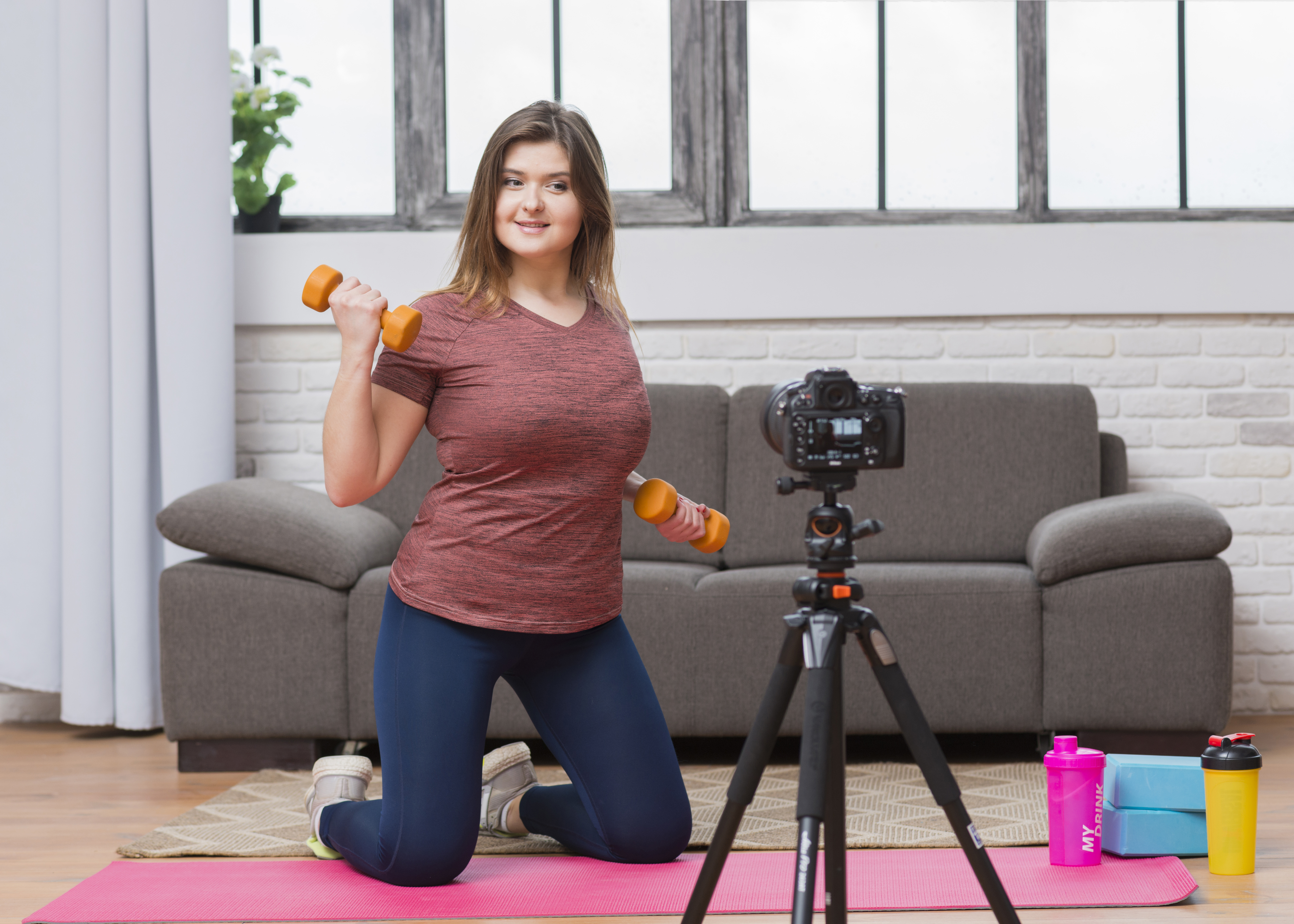 woman working out in front of camera
