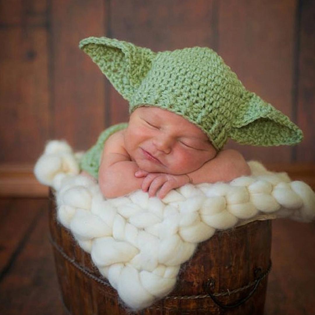 baby in baby yoda hat