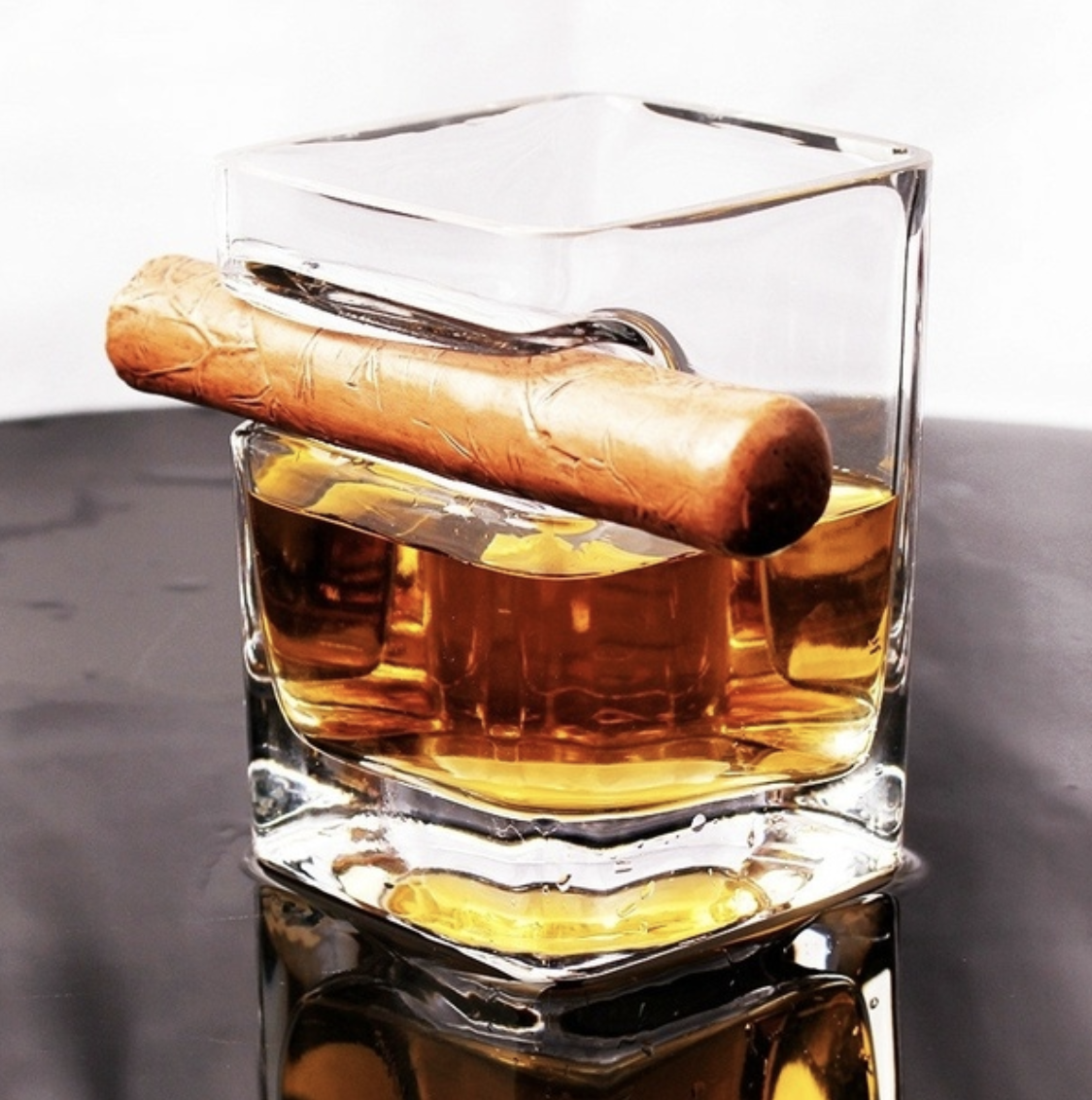 whiskey glass with cigar indentation rest