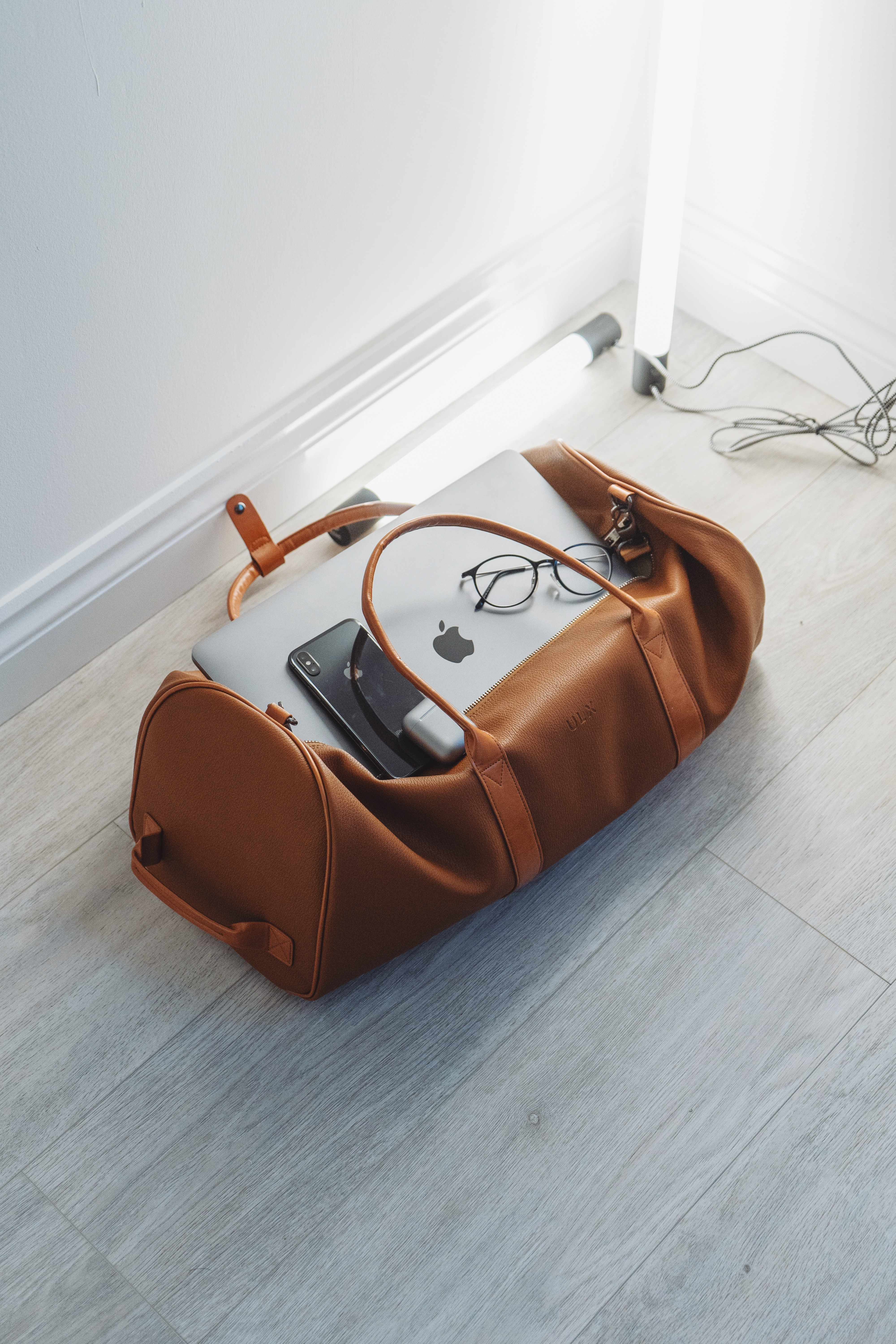 travel duffel bag with iphone and laptop